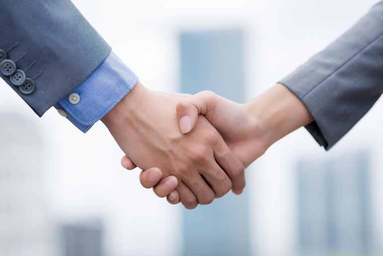 Close-up image of business people shaking hands